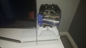 White PS4 two controllers 7 games may swap