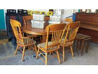 Large pine extending table and 6 highback chairs