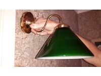 Two green glass coolie wall lamp shades