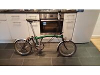 Green Brompton Bike: great condition but used. Lots of extras!