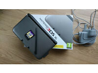 Nintendo 3DS XL with 4GB SD card, charger and 2 games