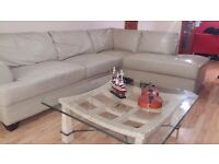 Cream leather corner suite 285 cm x 215 cm x 87 cm. delivery can be arranged if required