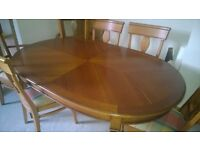 8 seater solid wood extending dining table and 8 chairs