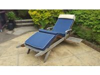 Hardwood sun lounger with cushion. Fully adjustable. On wheels for easy movement