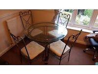 Glass round table with metal frame and 4 chairs!
