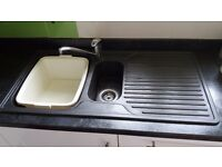 Black composite Kitchen sink with 1 1/2 bowl and drainer.