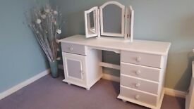 Grey and white dressing table with cupboard and drawers.