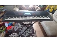Large Casio piano keyboard wk-1200