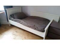 Wooden framed single bed