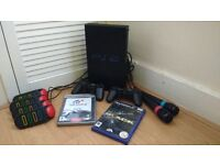 PS2 plus microphones plus 2 games