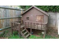 Wooden Playhouse With Decking