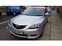 Mazda 3 for sale. Low-mileage, automatic. Genuinely low-mileage, silver. 3 owners, 2 keys