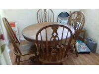 oak pedastal dining table and 4 chairs slight scuffing on table feet but other than that in vgc
