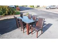 Dfs dark oak and black wood dinning table and 6 chairs