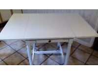 White Drop-leaf table.