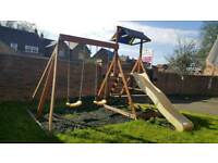 Wooden climbing frame slide swings