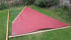 Dinghy lug sail and wooden mast.
