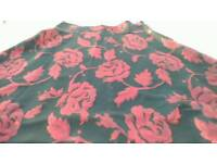 Ladies skirt black with red flowers