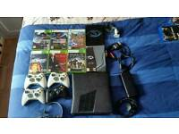 Xbox 360 slim Bundle with 8 games, 4 controllers and headset