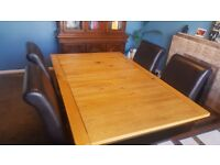 Keswick Dining table with 6 padded leather effect Darcy chairs brown
