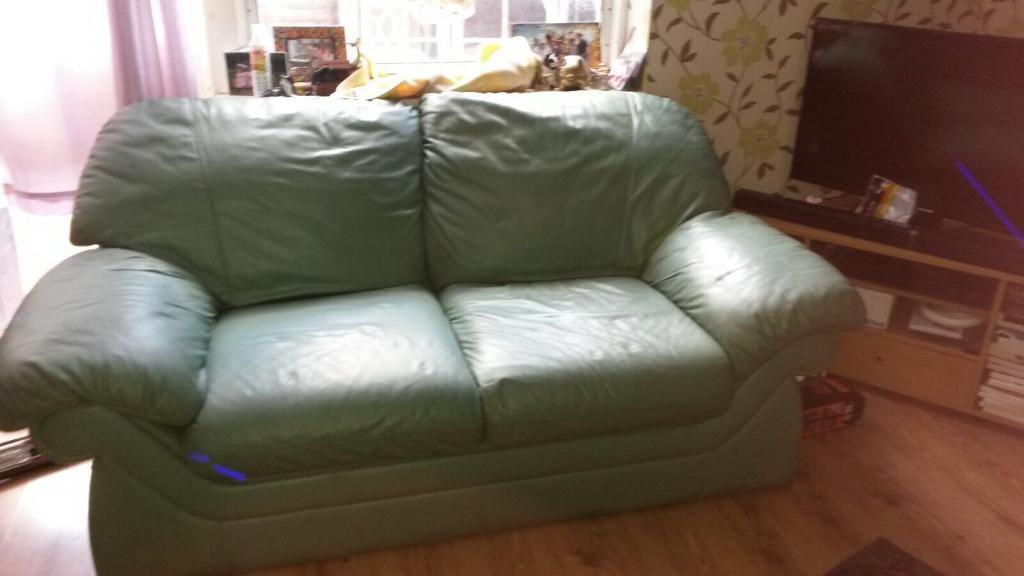 2 x green leather sofa