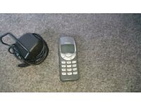Retro Nokia phone and charger