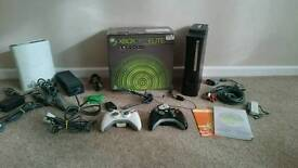 Xbox 360 120gb elite, 2 controllers and 6 games,dvd, plus more