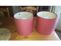 Two dark red lamp shades