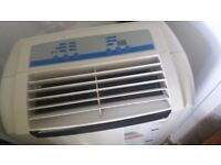 Large air con unit with vent pipe