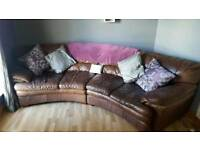 Soft faux leather banana shaped sofa and 2 seater