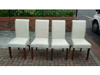 4 cream leather roll top dining room chairs