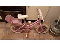 Girls pink bike with doll basket