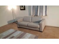 New Siesta oatmeal fabric 2,5 seater sofa bed