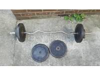 55kgs cast iron weights and an ez bar