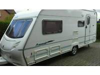 4 BERTH CARAVAN WITH MOTOMOVER £6475. plus extras