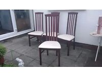 Set of 4 dining chairs in very good condition. Wood frame with cream seats. No marks or scratches.