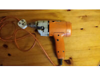 Black & Decker electric drill - working