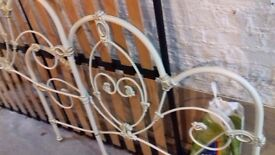 Cream wrought iron bed