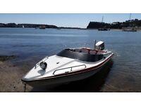 speed boat with Suzuki 85 dt 2 stroke outboard engine