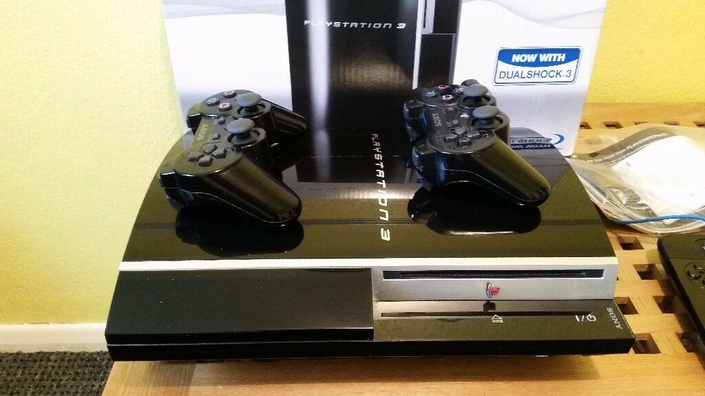 PLAYSTATION 3 WITH 22 GAMES AND 2 CONTROLLERS AND BOX