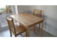Table and two chairs, solid hardwood, VGC, can deliver