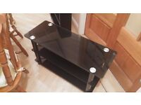 Black Glass TV stand in excellent condition, MUST GO THIS WEEKEND ONLY £10 !!!