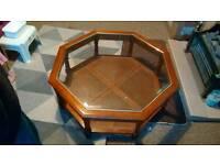 Hexagonal glass and dark wood coffee table