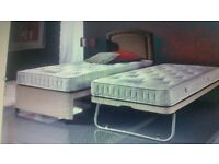 Single bed with guest bed underneath