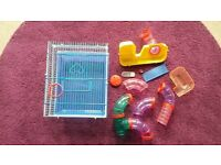 plastic and metal hamster cage with play tubes