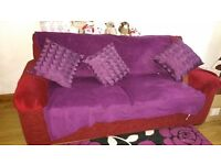 Two seater red sofa and two arm chairs for sale