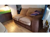 beige and brown corner sofa bed armchair and footstool