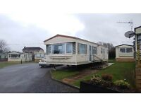 Cheap Central heated double glazed caravan for sale at Village holiday park nr New Quay West Wales