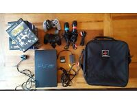 SONY Playstation 2 with 2 controllers, 2 mics, memory card, games etc
