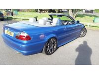 Rare m3 blue convertible 3 series lowrered with 19 alloys.